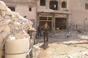 A Syrian army soldier loyal to Syria's President Assad …