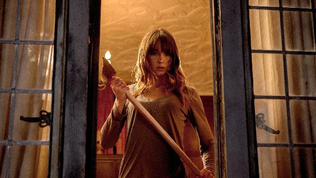 "This film publicity image released by Lionsgate shows Sharni Vinson in a scene from ""You're Next."" (AP Photo/Lionsgate, Corey Ransberg)"