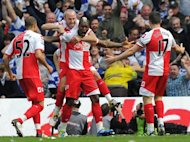 This file photo shows Queens Park Rangers&#39; players celebrating a goal during an English Premier League match in May. QPR will visit Malaysia and Indonesia next month in their first pre-season Asia tour, sponsor AirAsia has announced