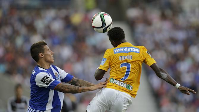 Porto's Tello jumps for the ball with Estoril's Mano during their Portuguese Premier League soccer match at Dragao stadium in Porto