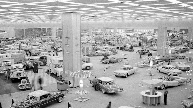 FILE - In this Oct. 14, 1960 file photo, people visit the National Auto Show at Cobo Hall in Detroit. Hundreds of thousands of buyers and car fans are expected to crowd Detroit's North American International Auto Show from Jan. 14-27, 2013. Some 800,000 visitors are expected to descend on the city's 18-acre Cobo Center, where more than 500 cars and trucks will be on display. (AP Photo/File)