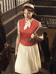 "FILE- This file photo released by AMC shows Elisabeth Moss as Peggy Olson in""Mad Men"". The show has helped bring back the '60s, including hats. (AP Photo/AMC Frank Ockenfels, FILE)"