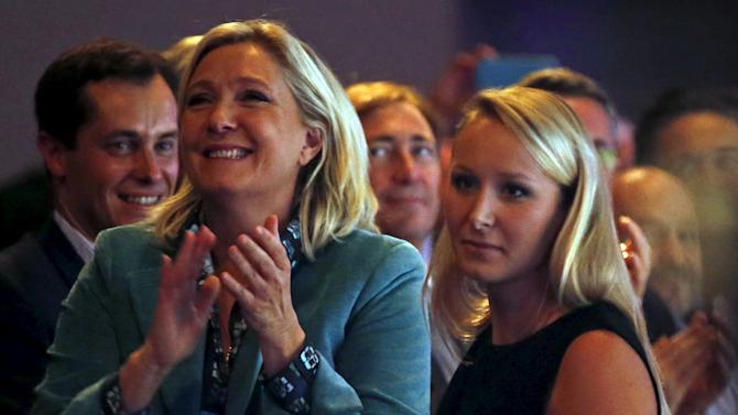 Le Pen, leader of France's National Front political party, applauds her niece Marechal-Le Pen), deputy of Vaucluse, after her speech during the National Front political party summer university in Marseille, France