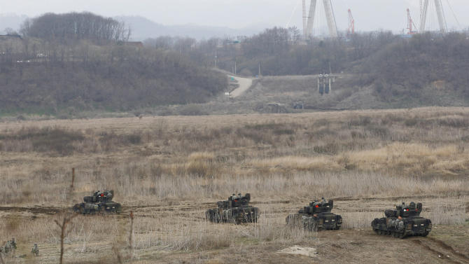 U.S. Army soldiers drive armored vehicles during annual military drills in Yeoncheon, South Korea, near the border with North Korea, Tuesday, April 9, 2013. North Korea has unleashed a flurry of war threats and provocations over U.N. sanctions for its last nuclear test, and over the ongoing U.S.-South Korean military drills, which the allies say are routine but Pyongyang says is a preparation for a northward invasion. (AP Photo/Ahn Young-joon)