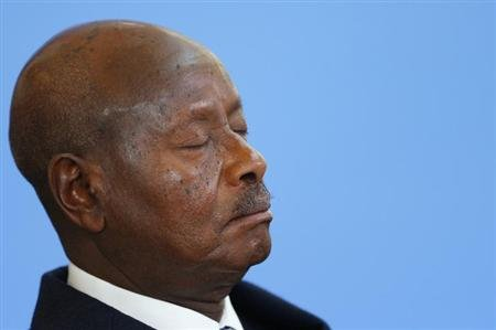 Uganda's President Yoweri Museveni closes his eyes as he listens to opening speeches at the Somalia conference in London May 7, 2013. REUTERS/Andrew Winning