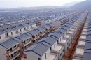File photo of newly built houses at Dadun village of Lingshui ethnic Li autonomous county