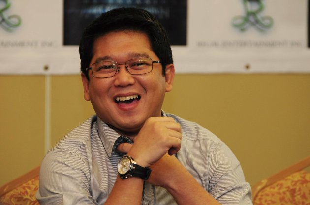Quezon City Mayor, Herbert Bautista laughs as he answers questions from journalists during his press conference for the movie Shake, Rattle and Roll 14 held at the Imperial Palace Suites in Tomas Morato, Quezon City on 17 November 2012. (Angela Galia/NPPA images)