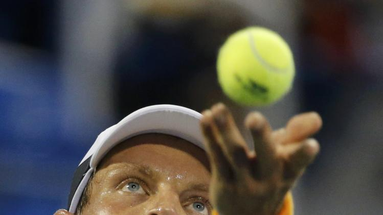 Berdych of the Czech Republic serves to Thiem of Austria during their fourth round match at the 2014 U.S. Open tennis tournament in New York