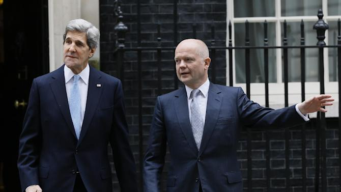 U.S. Secretary of State John Kerry, left, accompanies British Foreign Secretary William Hague as they leave Downing Street in London, Monday, Feb. 25, 2013. Kerry kicked off his first official overseas trip by meeting with British leaders in London on the first leg of a hectic nine-day dash through Europe and the Middle East. (AP Photo/Kirsty Wigglesworth)