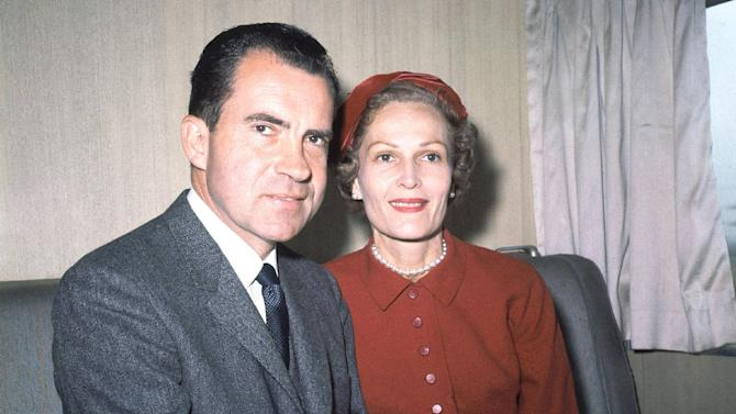 FILE - In this June 5, 1960 file photo, former President Richard Nixon, left, and his wife Pat pose for photos while campaigning at Rockefeller Center in New York. Six love letters between the 37th president and his wife will go on display Friday, March 16, 2012 as part of an exhibit at the Richard Nixon Presidential Library and Museum. The exhibit is intended to celebrate what would have been Pat Nixon's 100th birthday and is dedicated to her life and accomplishments. (AP File Photo)