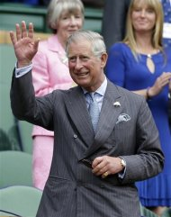 Britain's Prince Charles waves as he arrives in the Royal Box for the start of a second round men's singles between Roger Federer of Switzerland Fabio Fognini of Italy during a match at the All England Lawn Tennis Championships at Wimbledon, England, Wednesday, June 27, 2012. (AP Photo/Kirsty Wigglesworth)