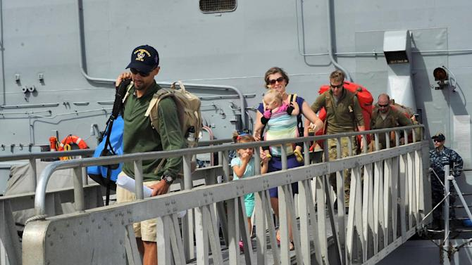 CORRECTS DATE TO APRIL 9 - This photo provided by the U.S. Navy shows the Kaufman family disembarking from the USS Vandegrift on Wednesday, April 9, 2014, at Naval Air Station North Island in San Diego, following their rescue at sea on April 6. Six days after the family of four found themselves helpless and adrift in a sailboat far into the Pacific with a vomiting and feverish 1-year-old aboard, a Navy warship delivered them safely to shore, where they had begun their attempted around-the world voyage before the child was born. (AP Photo/U.S. Navy)