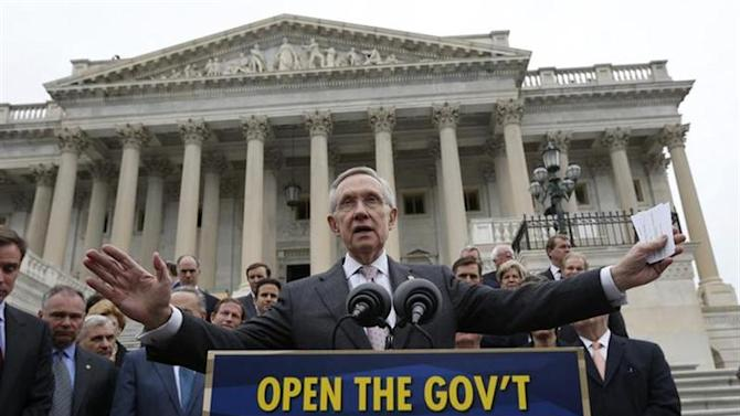 U.S. Senate Majority Leader Harry Reid (D-NV) gathers with other Democratic Party senate members on the steps of the U.S. Capitol in Washington, October 9, 2013. Reid called on Republican members of congress to negotiate an end to the U.S. Government shutdown entering its ninth day. REUTERS/Jason Reed