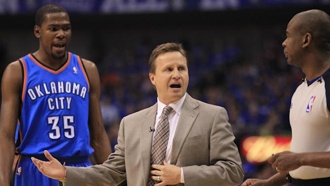 Oklahoma City Thunder head coach Scott Brooks, center and Kevin Durant argue a call with the referee during the first half of Game 4 in a first-round NBA basketball playoff series, Saturday, May 5, 2012, in Dallas. (AP Photo/LM Otero)