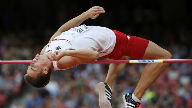 Wiesiolek of Poland competes in the high jump event of the men's decathlon during the 15th IAAF World Championships at the National Stadium in Beijing