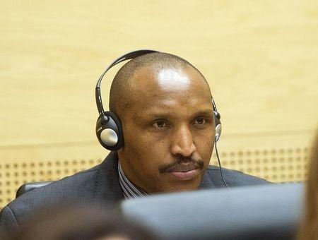 Congolese militia leader  Ntaganda appears at the International Criminal Court  charged with war crimes and crimes against humanity in a hearing  in The Hague