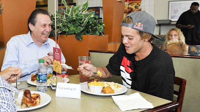 Boston Market CEO George Michel (A.K.A. The Big Chicken) and pro skateboarder Ryan Sheckler enjoy lunch at Boston Market during an event benefiting The Sheckler Foundation on Thursday, Aug. 23, 2012 in North Arlington, N.J. (Photo by Charles Sykes/Invision for Boston Market/AP Images)