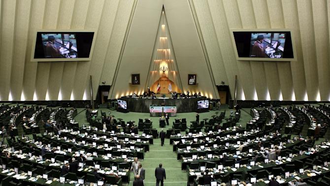 This Aug. 28, 2013, photo, shows a general view of Iran's parliament in Tehran. The U.S. has concluded that nearly half of Iran's monthly earnings from crude oil exports are accumulating in accounts overseas because of sanctions that restrict Tehran's access to the money. The estimates, provided to The Associated Press by a senior U.S. official and never released before, are the latest indication that new sanctions imposed in February are deepening Iran's economic distress and making it increasingly difficult to access billions of dollars in vital oil revenues. (AP Photo/Ebrahim Noroozi)
