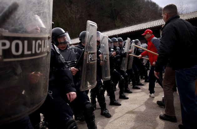Members of Special Police Force from Zenica participate during an anti soccer hooligan exercise with people role-playing as demonstrators in Nemila