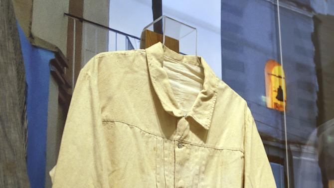"In this Wednesday, Oct. 17, 2012 photo, a guayabera said to have been worn by the Spanish military in 1897 in Cuba, is on display at an exhibition titled ""The Guayabera: A Shirt's Story"" at the Museum of History Miami, in Miami. This is the first exhibition to trace the story of the shirt's evolution through Cuba, Mexico, and the United States. (AP Photo/Lynne Sladky)"