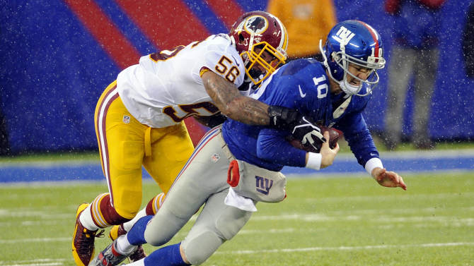 Eli Manning sprains ankle in Giants' win