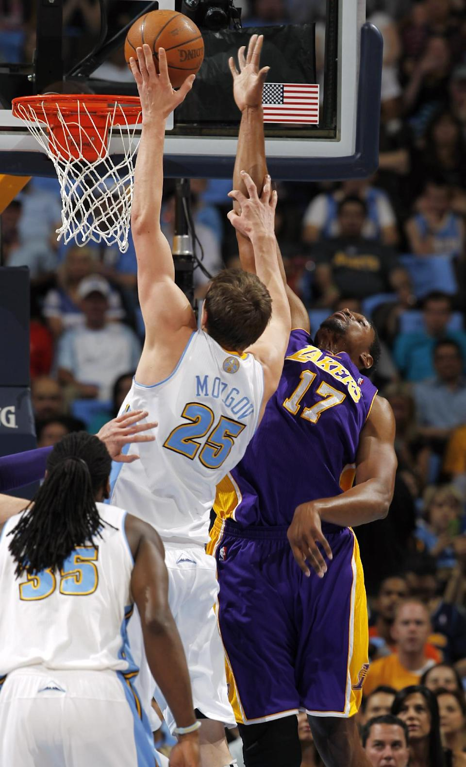 Los Angeles Lakers center Andrew Bynum, right, reaches up to stop a shot by Denver Nuggets center Timofey Mozgov, of Russia, in the first quarter of Game 3 of the teams' first-round NBA playoff series in Denver on Friday, May 4, 2012. (AP Photo/David Zalubowski)