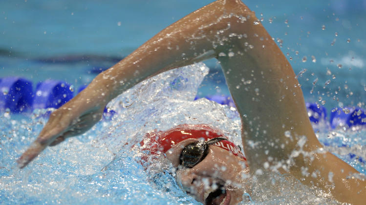 Britain's Rebecca Adlington competes to win bronze in the women's 400-meter freestyle swimming final at the Aquatics Centre in the Olympic Park during the 2012 Summer Olympics in London, Sunday, July 29, 2012. (AP Photo/Mark J. Terrill)