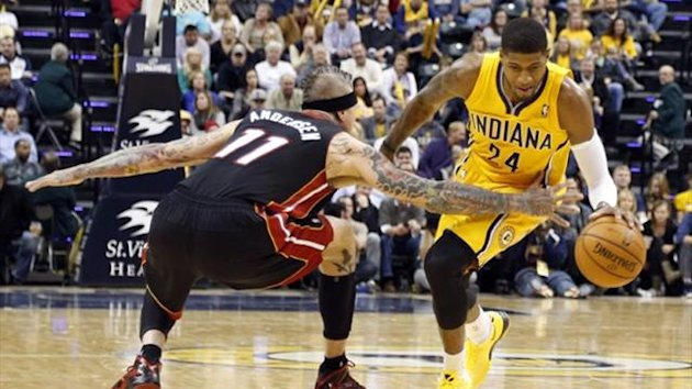 Indiana Pacers forward Paul George (24) drives to the basket against Miami Heat center Craig Andersen (11) (Reuters)