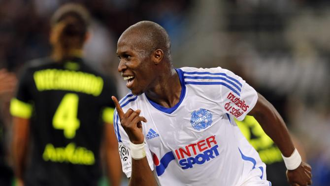 Olympique Marseille's Rod Fanni celebrates his goal against FC Nantes during their French Ligue 1 soccer match in Marseille