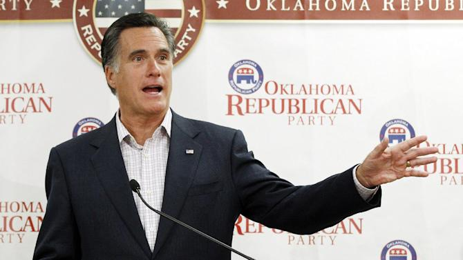 Republican presidential candidate former Massachusetts Gov. Mitt Romney, gestures as he speaks to supporters at Oklahoma state Republican Party Headquarters in Oklahoma City, Wednesday, May 9, 2012. Romney repeated his view that marriage should be restricted to one man and one woman, highlighting a sharp contrast with President Barack Obama. (AP Photo/Sue Ogrocki)