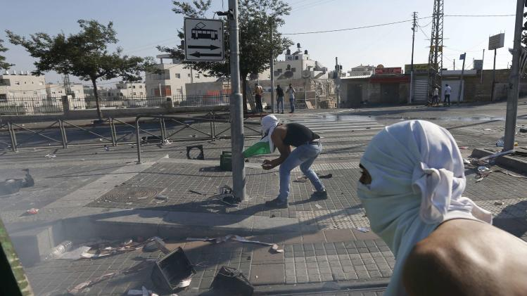 File picture of Palestinians throwing stones in Shuafat
