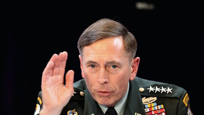 Gen. David Petraeus, the top U.S and NATO commander addresses RUSI members on 'The International Mission in Afghanistan', at the United Services Institute in central London, Friday Oct. 15, 2010.  Petraeus has confirmed that NATO has provided safe passage for top Taliban leaders to travel to Kabul for face-to-face negotiations with the American-backed Afghan government.    (AP Photo/Dan Kitwood, Pool)