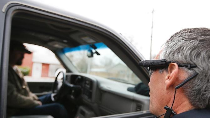 patrol officer performs a traffic stop on the first day of use of ...