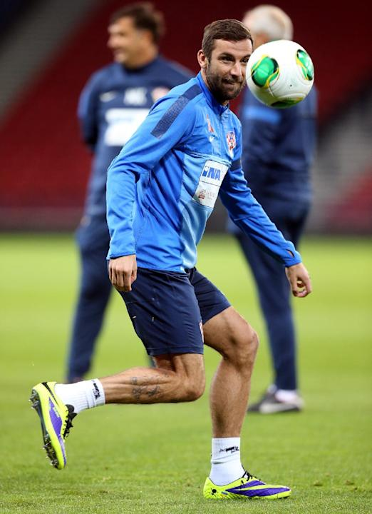 Croatia's captain Darijo Srna controls the ball during a team training session at Hampden Park, Glasgow, Scotland, Monday Oct. 14, 2013. Croatia face Scotland in a World Cup qualifying Group A  soccer