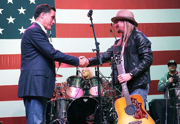 Republican presidential candidate Mitt Romney greets Kid Rock