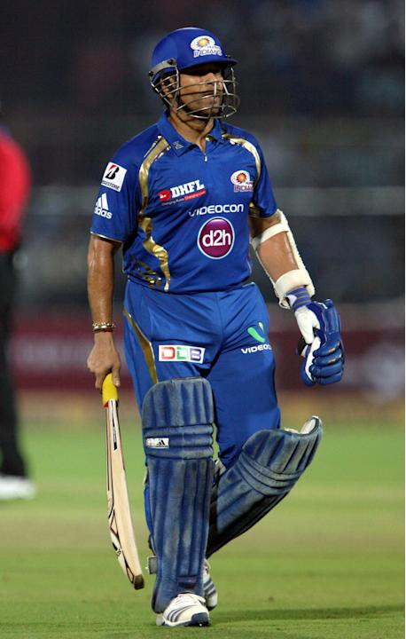 Mumbai Indians batsman Sachin Tendulkar returning to pavillion after getting out during the CLT20 match against Rajasthan Royals at Sawai Mansingh Stadium, Jaipur on Sept. 21, 2013. (Photo: IANS)
