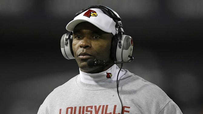 Charlie Strong tells Louisville he's off to Texas