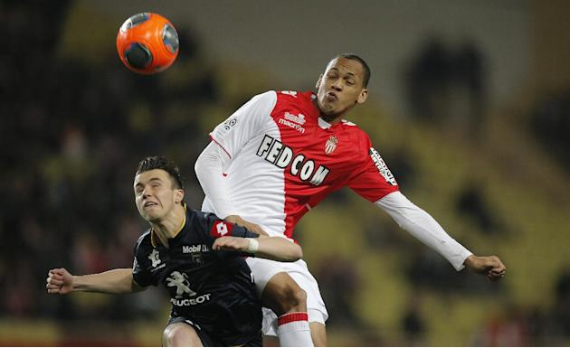 Monaco's Fabinho of Brazil, right, challenges for the ball with Sochaux Sebastien Corchia of France during their French League One soccer match, in Monaco stadium, Saturday, March 8 , 2014