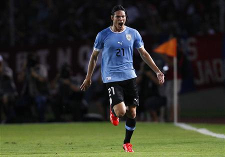 Uruguay's Cavani celebrates after scoring against Venezuela during their 2014 World Cup qualifying soccer match in Puerto Ordaz