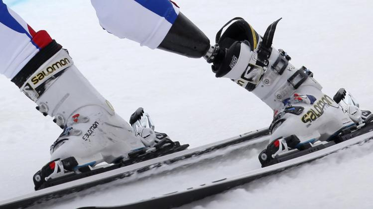 France's Amafroi-Broisat prosthesis is seen during men's skiing Super-G standing event at 2014 Sochi Paralympic Winter Games in Rosa Khutor