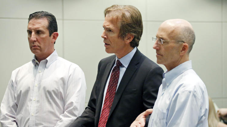 Mark Mayfield, a member of the board of the Central Mississippi Tea Party, right, listens as his attorney Merrida Coxwell, center, responds to questions from city judge Dale Danks in Madison, Miss., city court, Thursday, May 22, 2014, during an initial court appearance on a charge of conspiracy in relation to the alleged illegal photographing of the ailing wife of U.S. Sen. Thad Cochran, R-Miss., without her permission at the nursing home where she's lived for 13 years. Assisting with Mayfield's defense is attorney John Reeves, left. (AP Photo/Rogelio V. Solis)