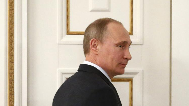 Russian President Putin leaves after a video conference with Miller, the head of Gazprom, at the Novo-Ogaryovo state residence outside Moscow