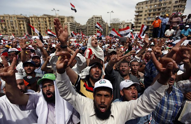 Egyptians chant slogans as they protest in Tahrir square in Cairo, Egypt, Friday, May 4, 2012. Thousands rallied in Egypt against the country&#39;s ruling military council on Friday, two days after a flare-up of street violence left at least nine dead and fueled a wave of Islamist-led opposition to the generals ahead of presidential elections. (AP Photo/Khalil Hamra)