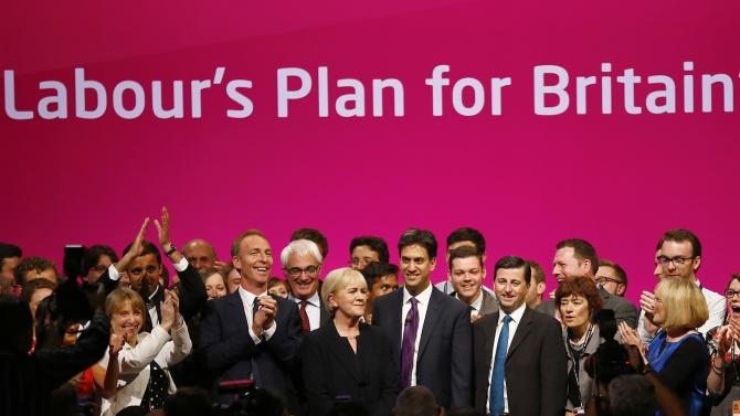 Britain's opposition Labour Party leader Ed Miliband takes to the stage with members of the Scottish Labour Party during Labour's annual conference in Manchester