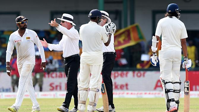 Umpire Nigel Llong (2nd L) breaks up a heated exchange between India's Ishant Sharma (R) and Sri Lanka's Lahiru Thirimanne (L) during the fourth day of their third and final Test in Colombo on August 31, 2015