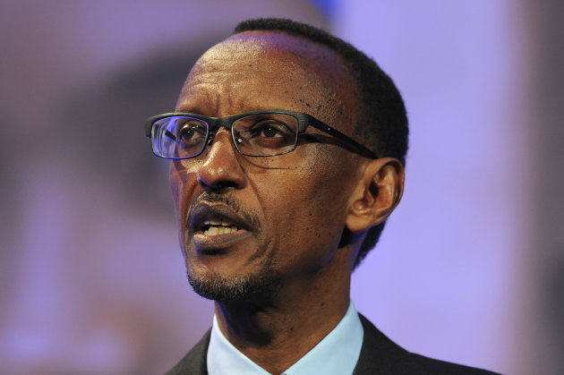 FILE - In this July 11, 2012 file photo Rwanda President Paul Kagame speaks during the London Summit on Family Planning in central London. On Friday Aug. 17, 2012 Rwandan and Congolese groups opposed to Rwanda President Paul Kagame's rule have asked the International Criminal Court in The Hague, Netherlands, to investigate him for alleged war crimes for backing rebel groups in eastern Congo. Prosecutor Fatou Bensouda has not said whether she plans to investigate Kagame. She is already investigating militia leaders in Congo with ties to his regime. (AP Photo/Carl Court, Pool, File)