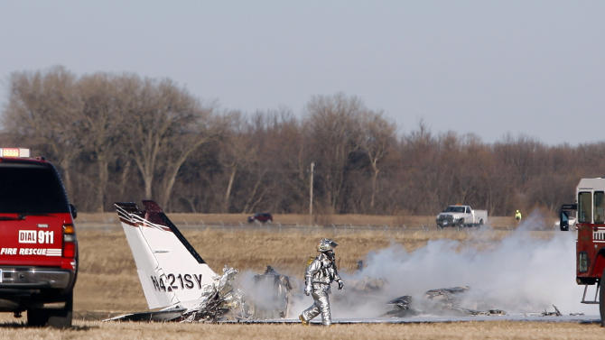 Emergency personnel respond to a plane crash in a field off Westport Ave. and 60th St. N. just west of the Sioux Falls Regional Airport in Sioux Falls, S.D., Friday, Dec. 9, 2011. (AP Photo/The Argus Leader, Devin Wagner)
