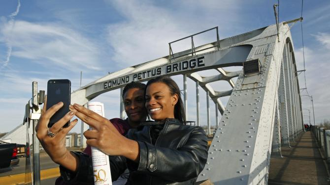 Lazette Bowens and her daughter Zoe take a selfie at the Edmund Pettus Bridge in Selma, Alabama