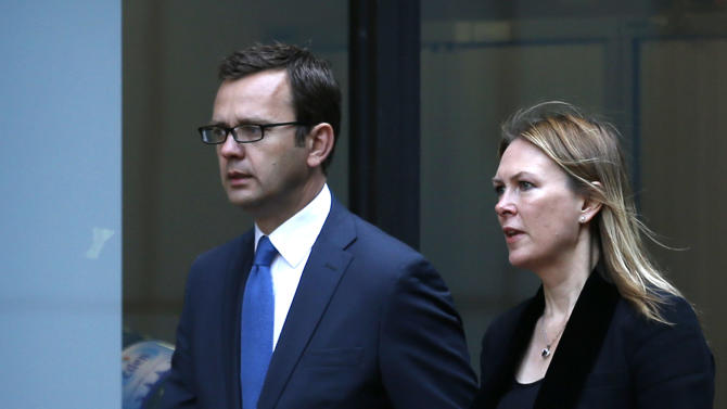 Andy Coulson, former News of the World editor and aide to British Prime Minister David Cameron, left, arrives at Southwark Crown Court in London where he will appear to face charges related to phone hacking, Thursday, June 6, 2013. (AP Photo/Sang Tan)