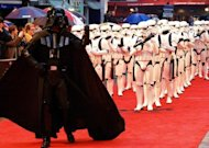 "Actors dressed as Darth Vader and Storm Troopers attend the London Premiere of Star Wars Episode III, Revenge of the Sith. The first ""Star Wars"" film came out in 1977, and there have been two trilogies -- three films from 1977-1983 and three prequels from 1999-2005 -- while the brand has expanded into theme parks and a huge merchandising arm"